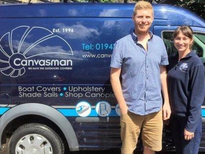 Chris Salisbury and Fran Salisbury next to a Canvasman van