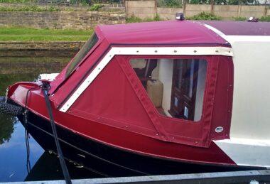 Custom red narrow boat cratch hood with window