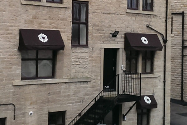 Custom Brown French Canopies With White Flower Design Signage