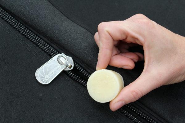 applying beeswax to zips