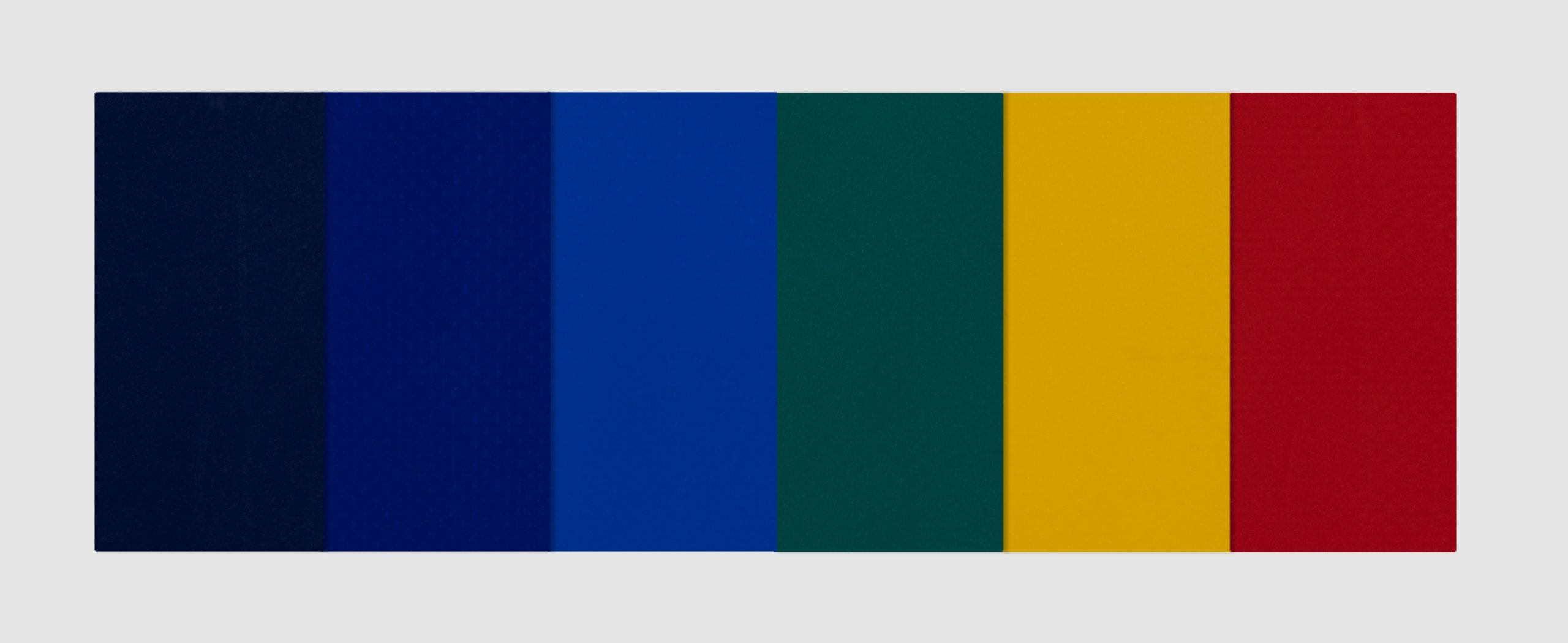 Matte PVC Fabrics in navy, dark blue, mid blue, green, yellow and red