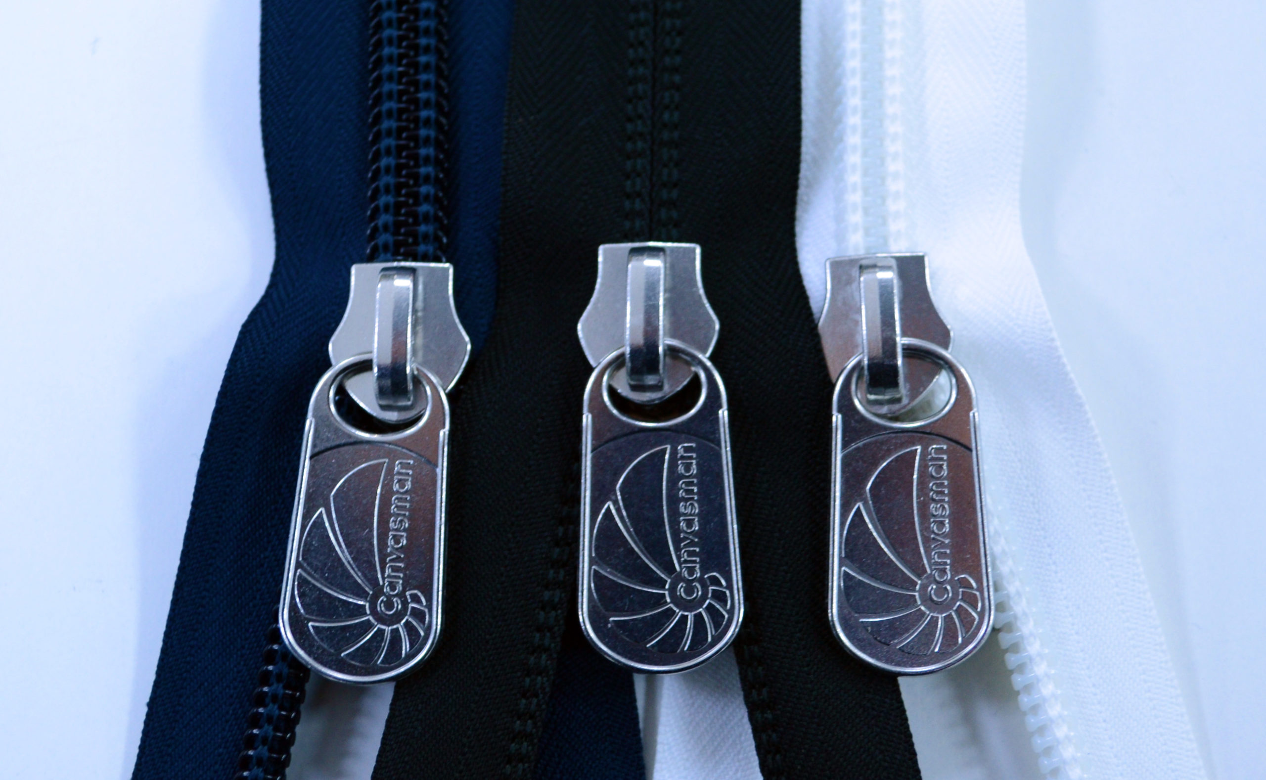 Navy blue, black and white Canvasman heavy duty zips